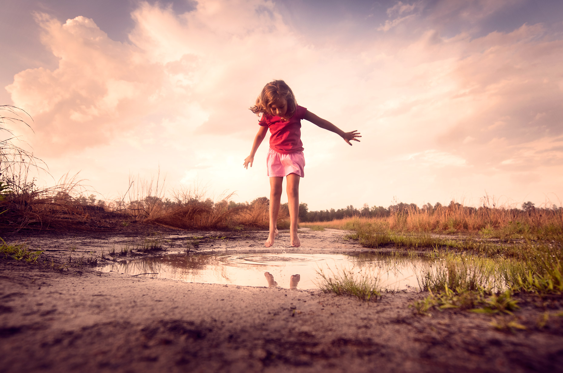 Campaign-girl-jumping-in-puddle